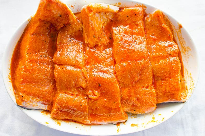 salmon marinade over salmon slices