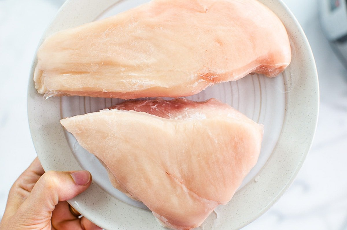 frozen chicken breasts on a plate