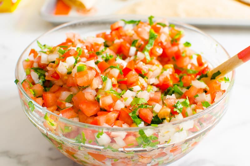 homemade Pico de Gallo in a bowl with a spoon