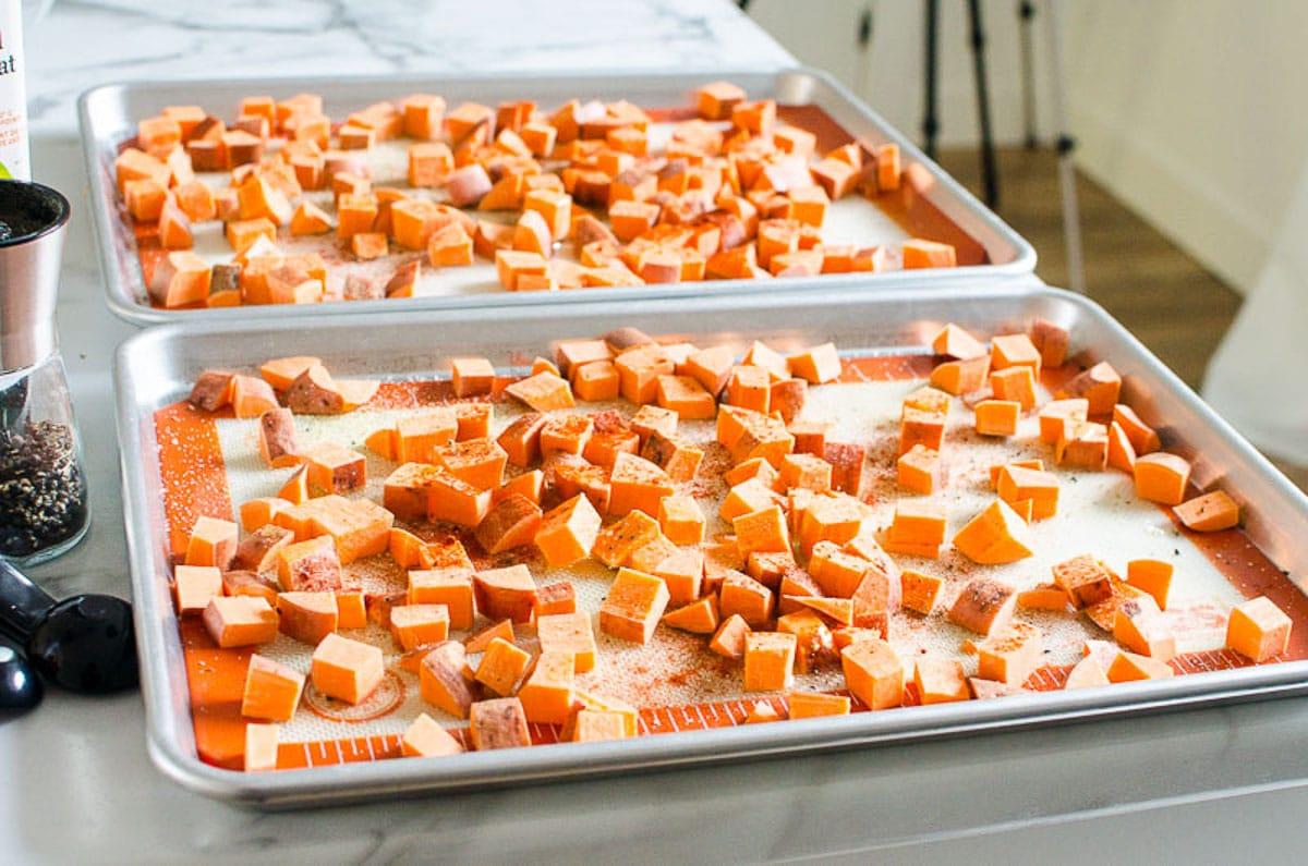 sweet potato chunks on sheet pans