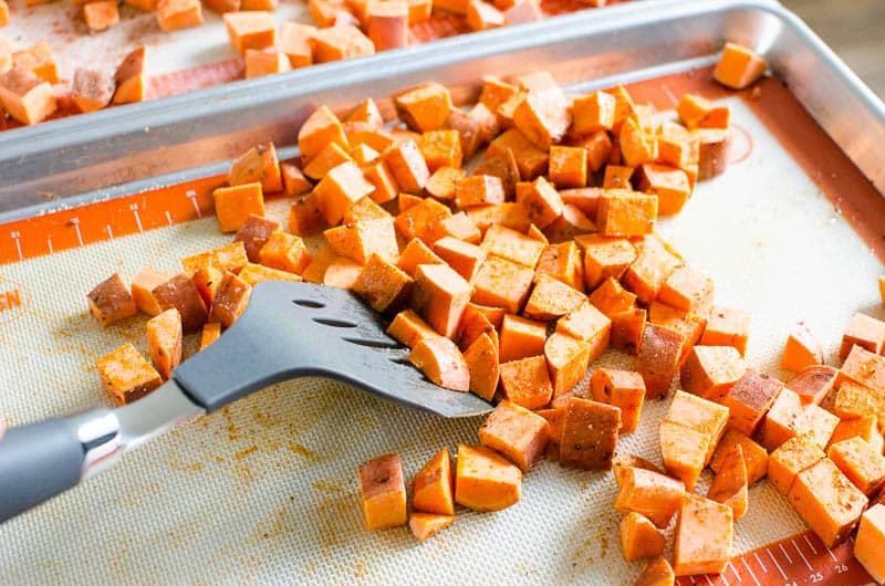 tossing sweet potatoes cubes