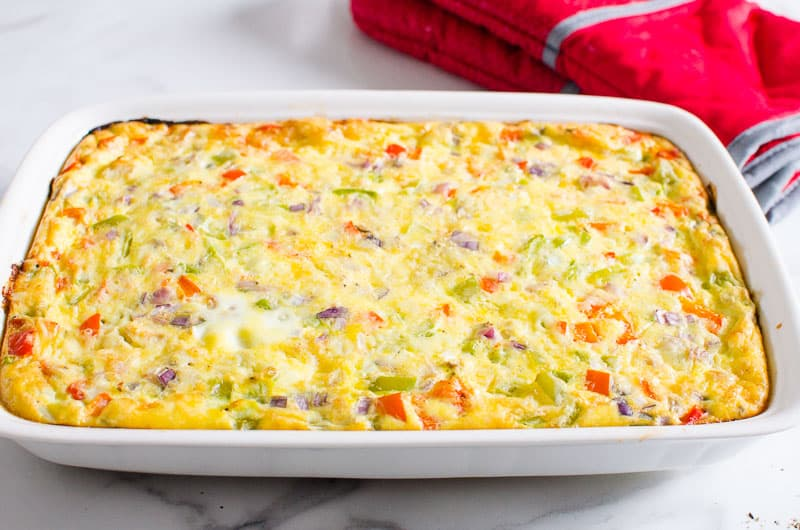 Healthy Breakfast Casserole on a counter and red oven mitts