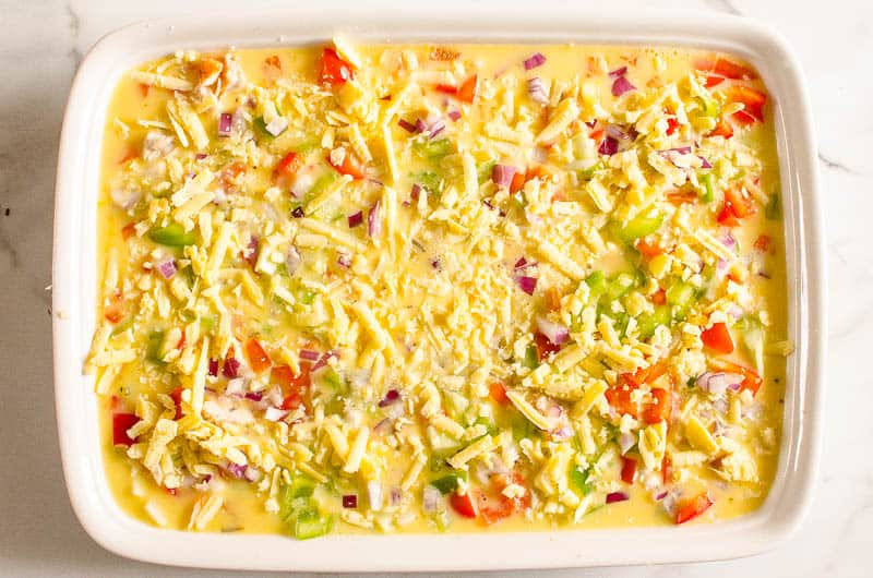 sprinkle red onion and cheese on breakfast egg bake casserole