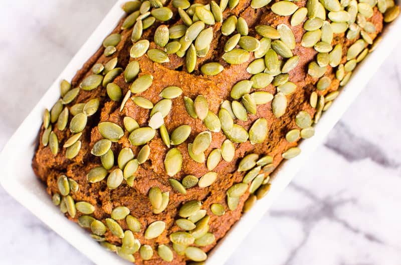 healthy pumpkin bread recipe garnished with pumpkin seeds