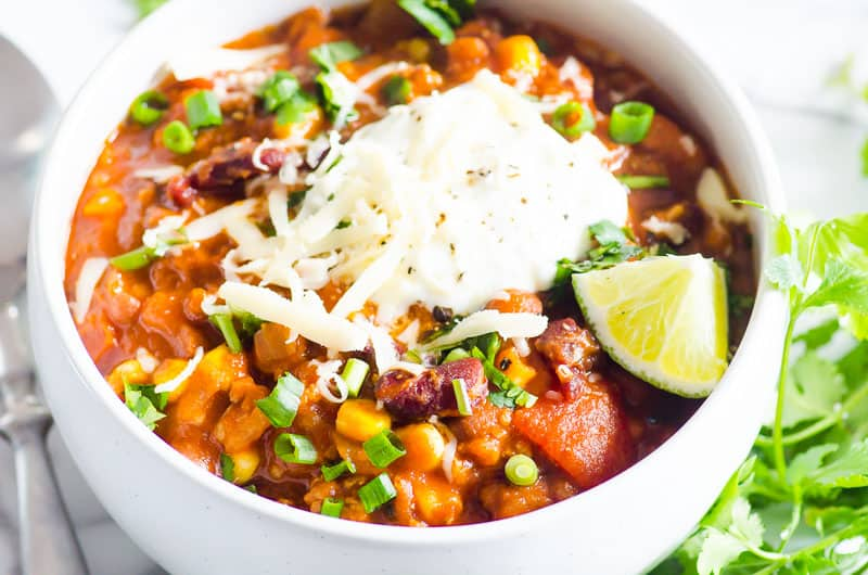 Instant Pot Turkey Chili garnished with yogurt, cheese, lime and cilantro