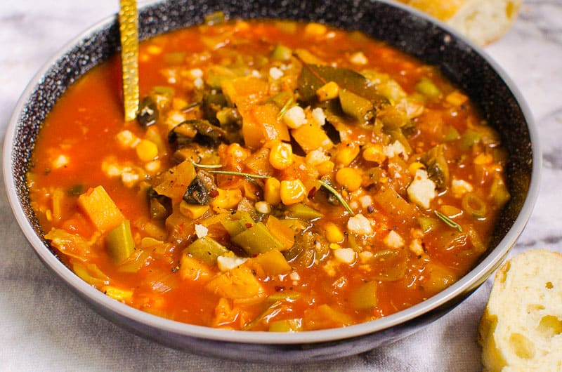 a bowl with a spoon of Instant Pot vegetable soup