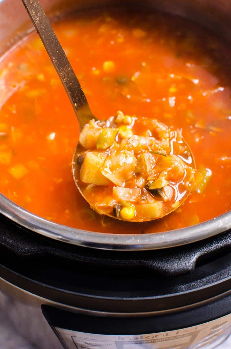 pressure cooker vegetable soup on a ladle
