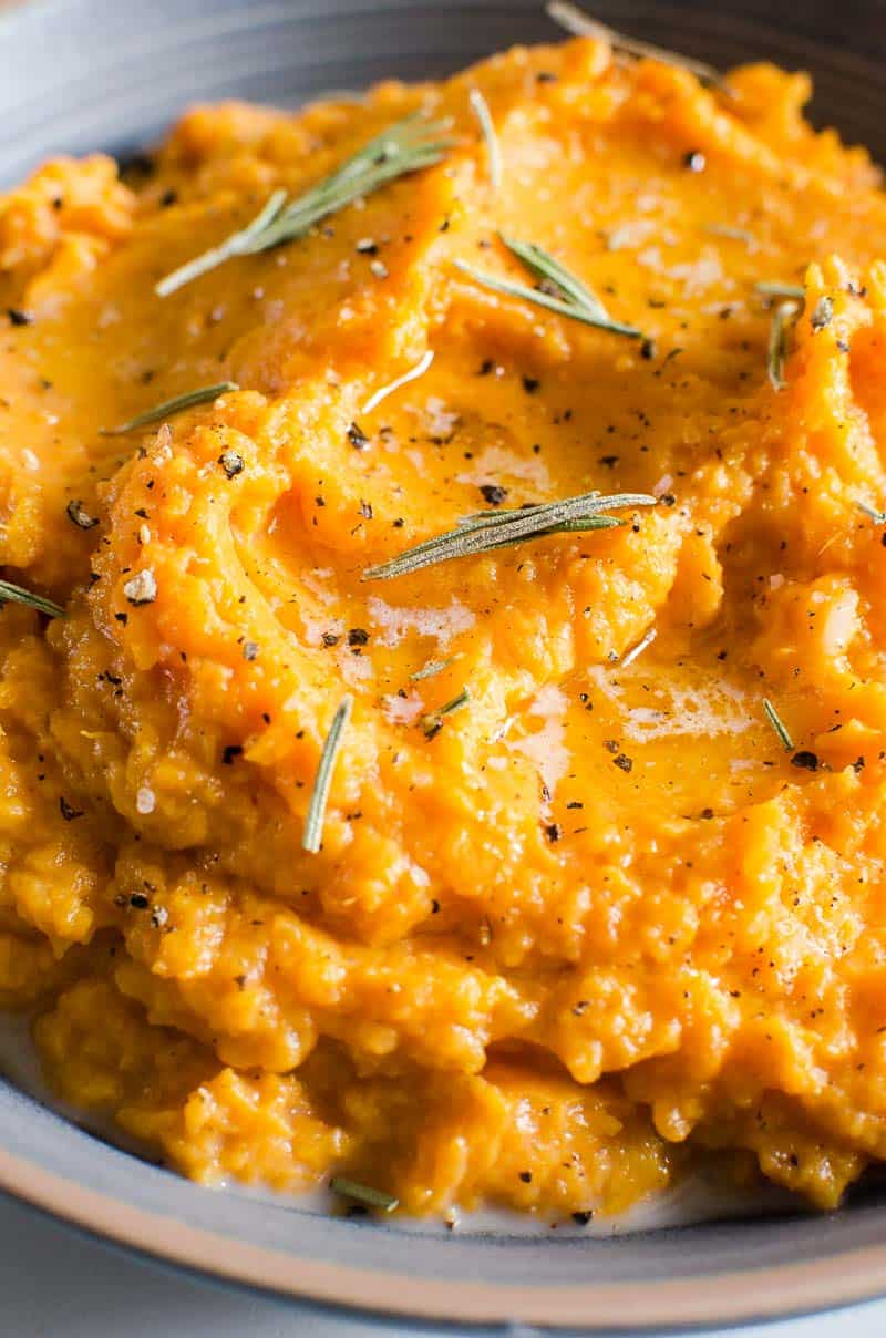 Mashed Sweet Potatoes with melted butter, pepper and rosemary