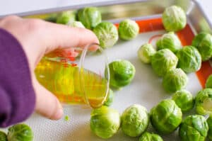drizzling brussels sprouts with olive oil