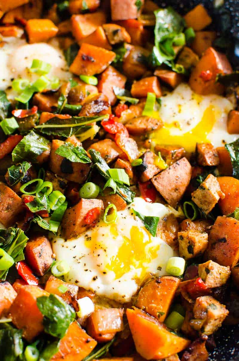 Sweet Potato Hash with eggs, kale and garnished with green onion