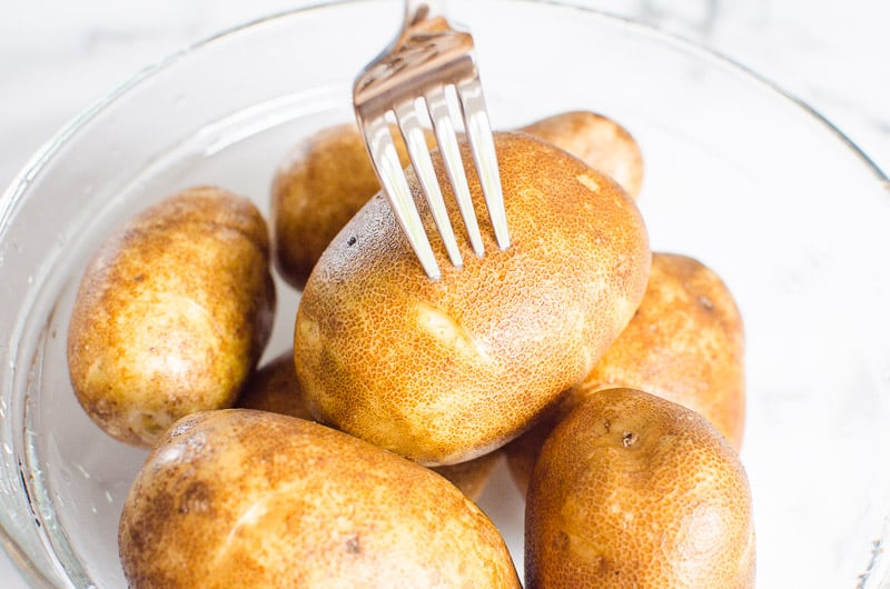 fork pricking potatoes