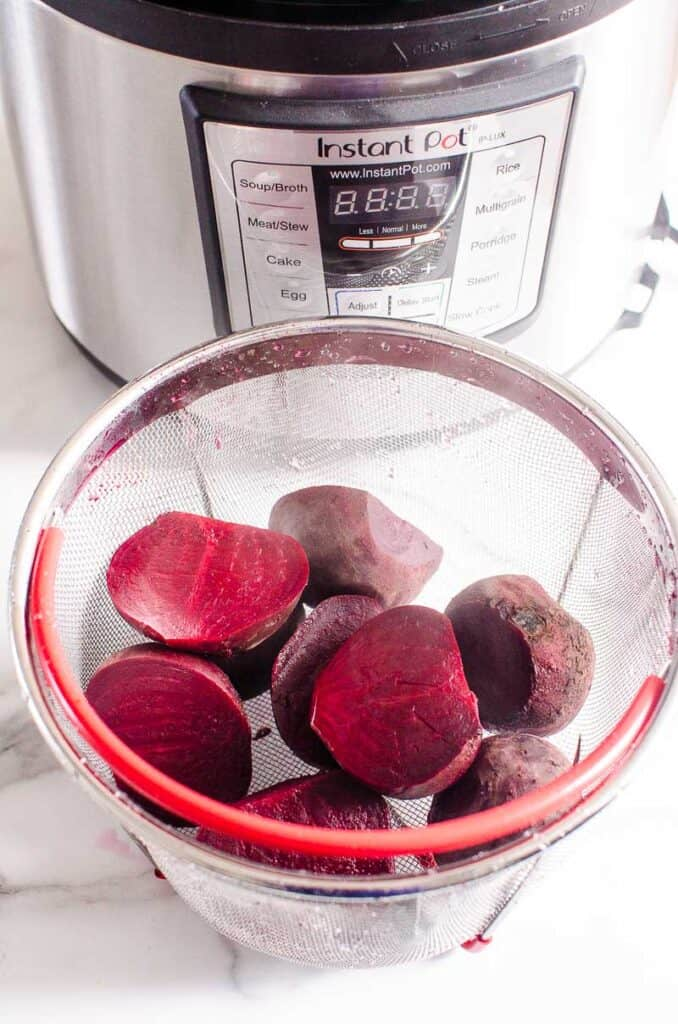 beets in strainer for pressure cooker beets - instant pot in background