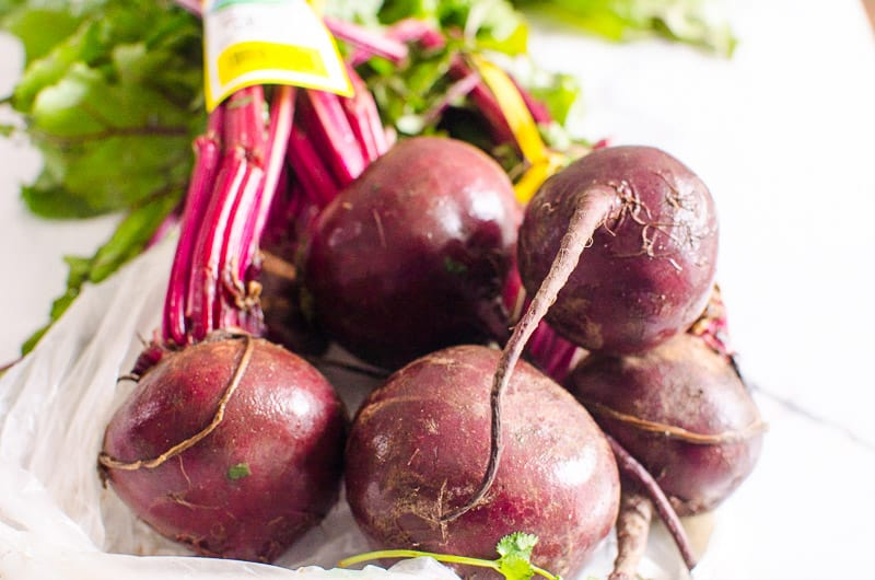 a bunch of beets with stems and leaves for pressure cooker beets
