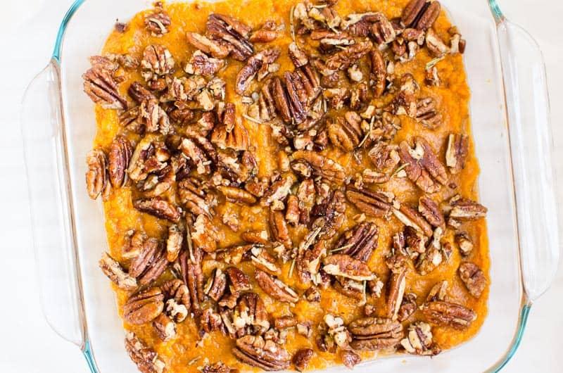 healthy sweet potato casserole in a glass baking dish