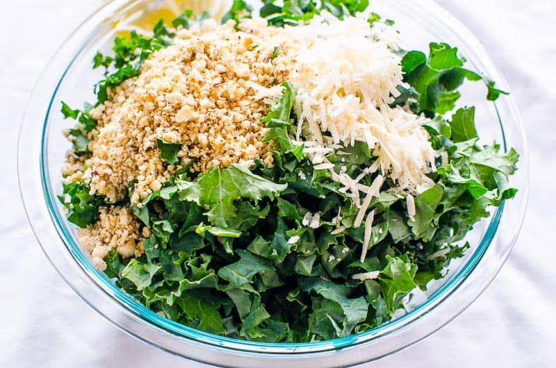kale salad in a glass bowl