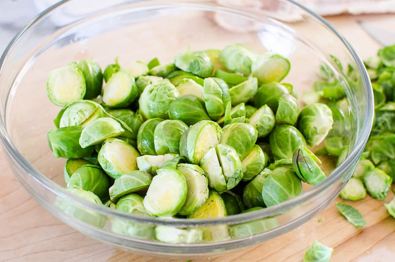 sliced brussels sprouts in a glass bowl