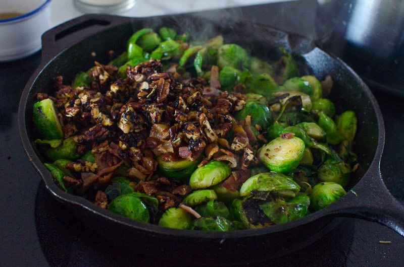 brussels sprouts and pecans in a cast iron skillet