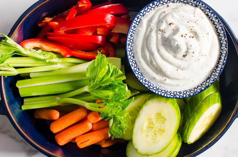 greek yogurt dip on a platter with veggies