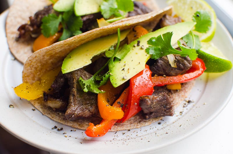 Steak Fajitas in whole wheat tortilla with avocado, cilantro and lime