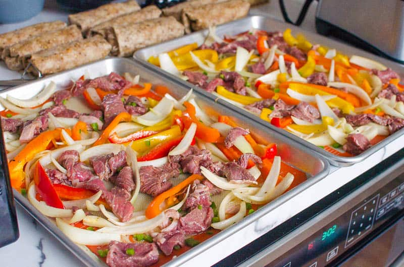 sheet pan steak fajitas on a counter