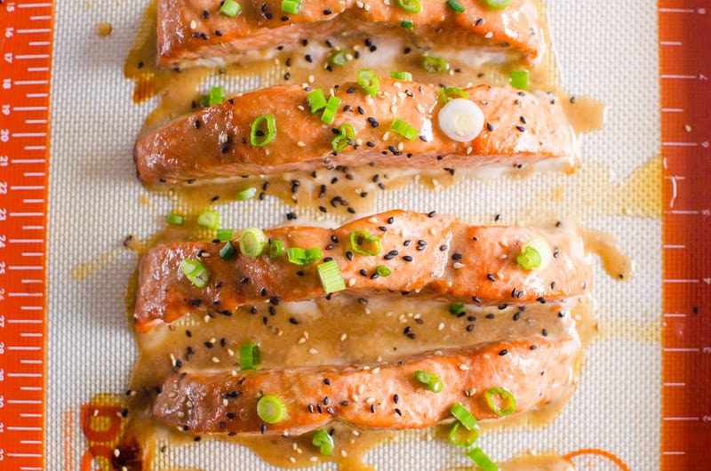 Teriyaki Salmon garnished with sesame seeds and green onion