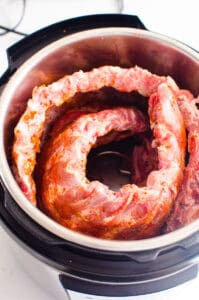 Instant Pot Ribs arranged inside pot and ready to cook