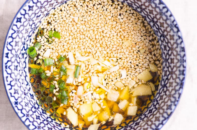 asian salad dressing in a blue bowl