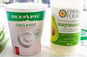container of greek yogurt and jar of avocado mayonnaise