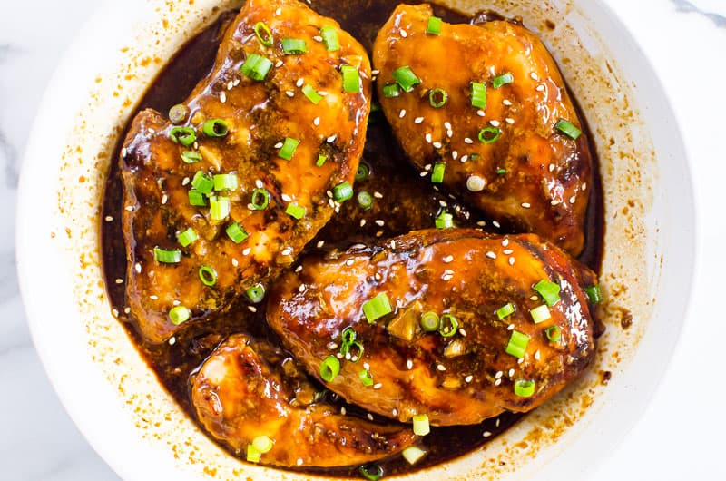 Honey Garlic Chicken garnished with green onion and sesame seeds