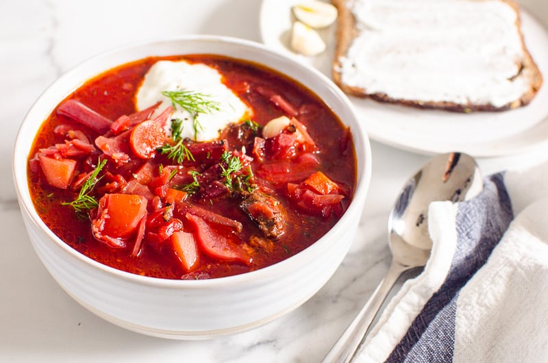 borscht served in a bowl with dollop of yogurt