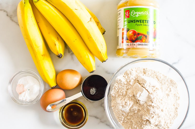 ingredients for Healthy Banana Bread are eggs, applesauce, maple syrup, whole wheat flour and bananas