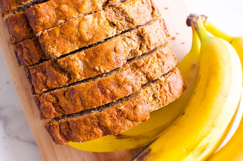 Healthy Banana Bread slices and a bunch of bananas