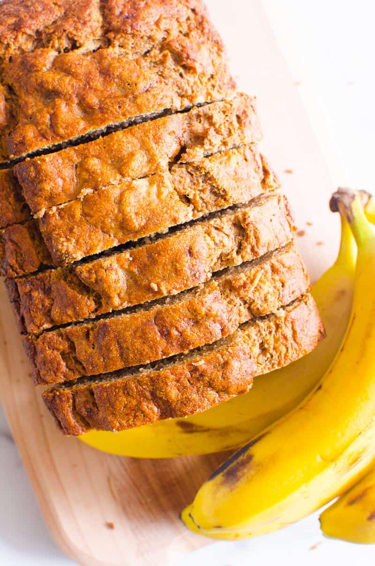 Healthy Banana Bread sliced on a cutting board