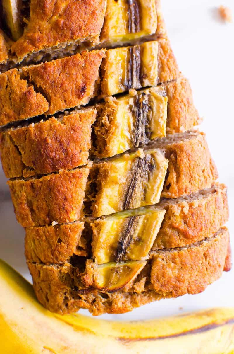 Healthy Banana Bread garnished with banana and sliced