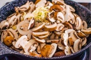 adding mushrooms to skillet