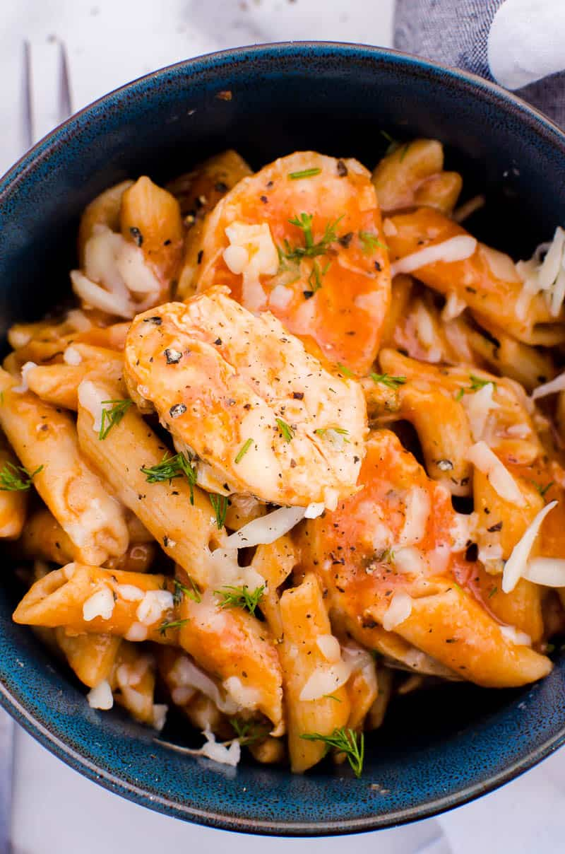 Instant Pot Parmesan Chicken Pasta served in blue bowl