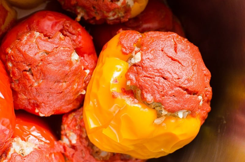 Instant Pot Stuffed Peppers topped with tomato sauce