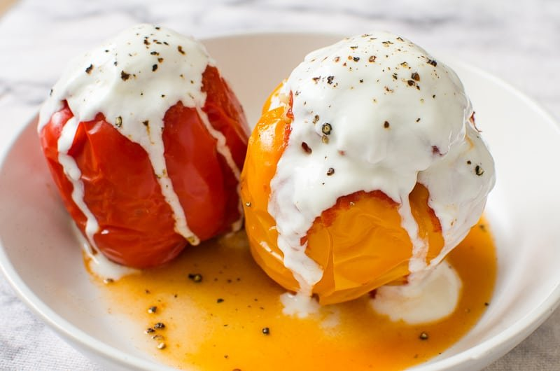 Instant Pot Stuffed Peppers recipe served on a plate and garnished with yogurt and pepper