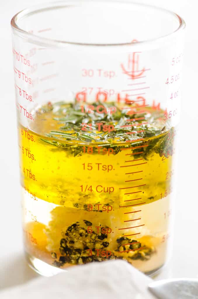 tuscan salad dressing in a glass measuring cup