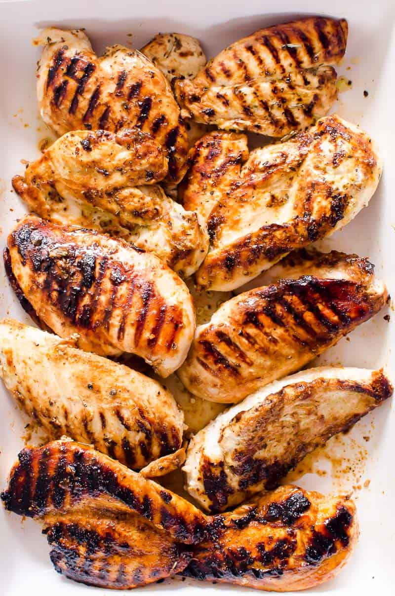 Grilled chicken breasts on a baking dish