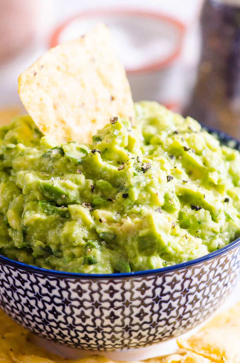 Tortilla chip dunked in a Guacamole