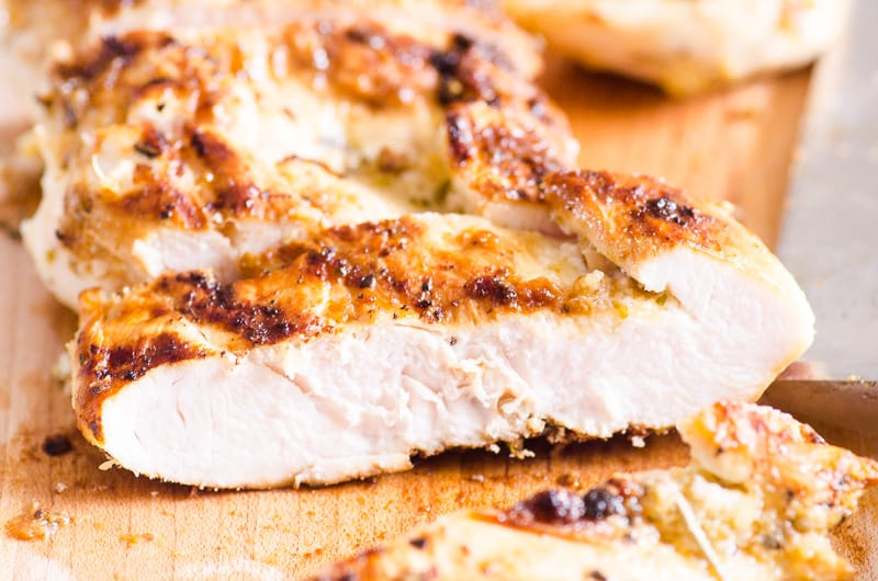 Sliced Grilled Chicken Breast on a cutting board