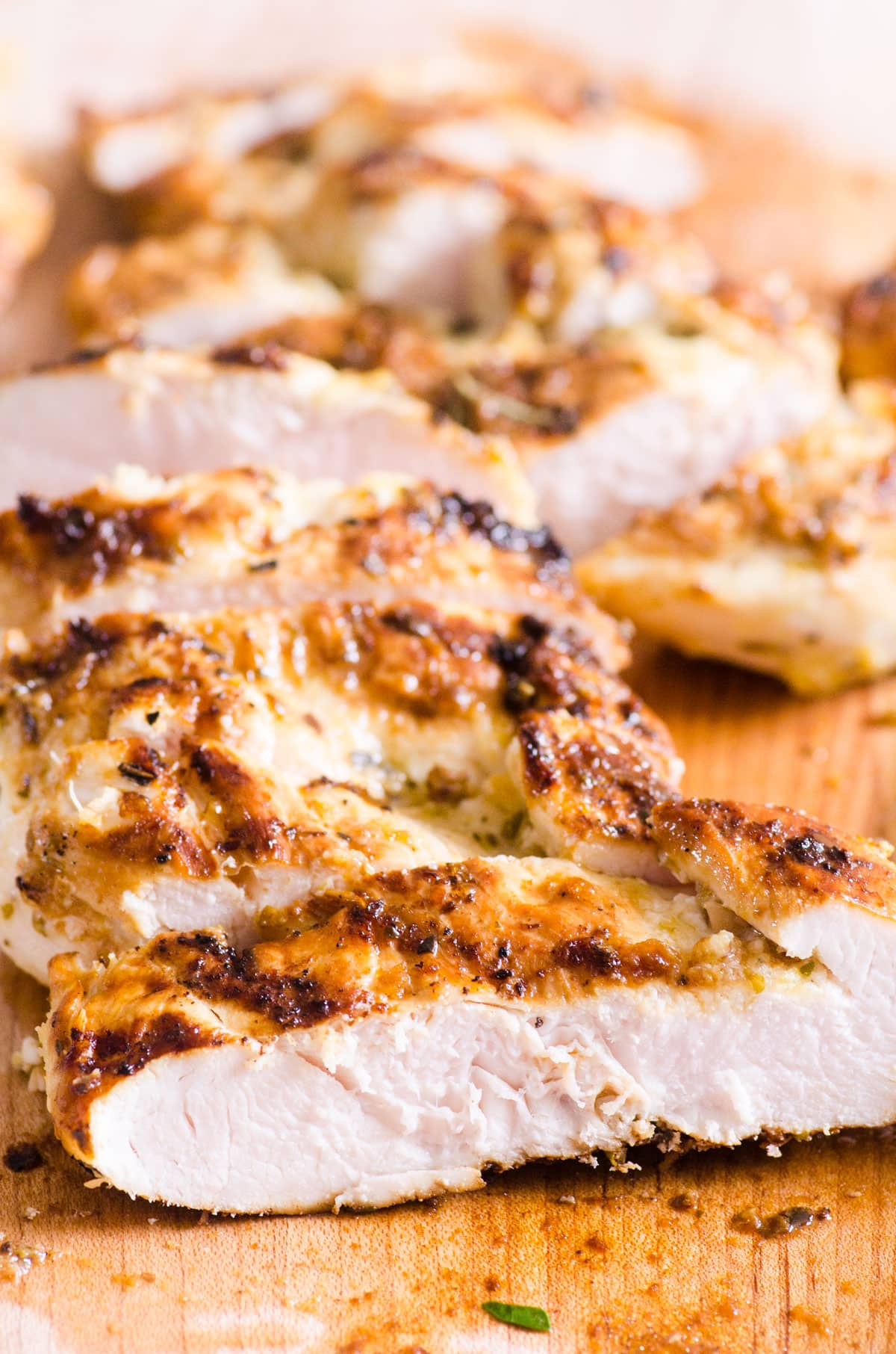 Grilled Chicken Breast sliced on a cutting board