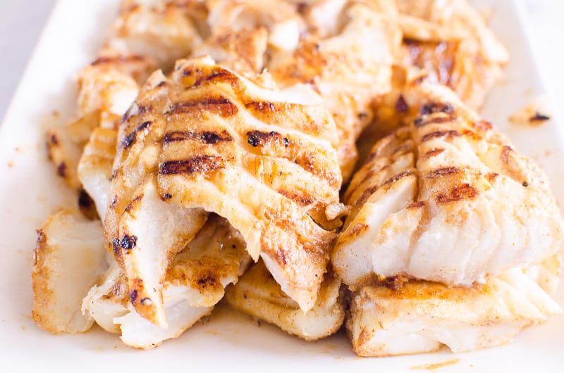 grilled cod fish on a platter