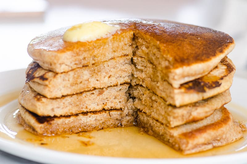 whole wheat pancakes stack cut to show texture and melted butter on top