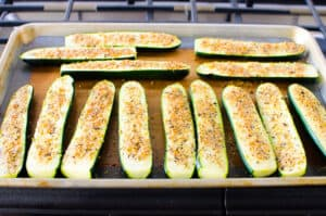 Parmesan Zucchini Sticks baked on a baking sheet