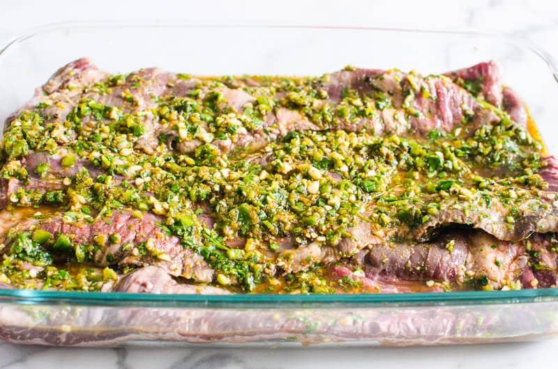 carne asada marinade poured over skirt steak