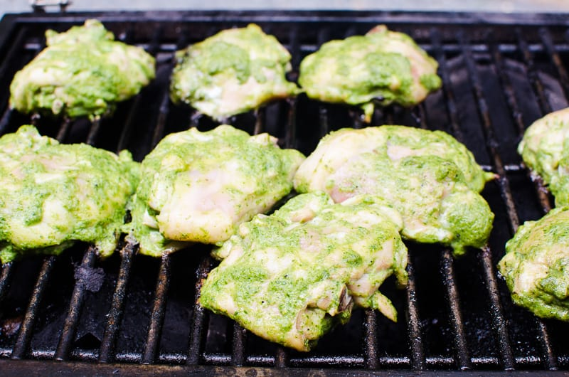 chicken thighs grilling on the grill