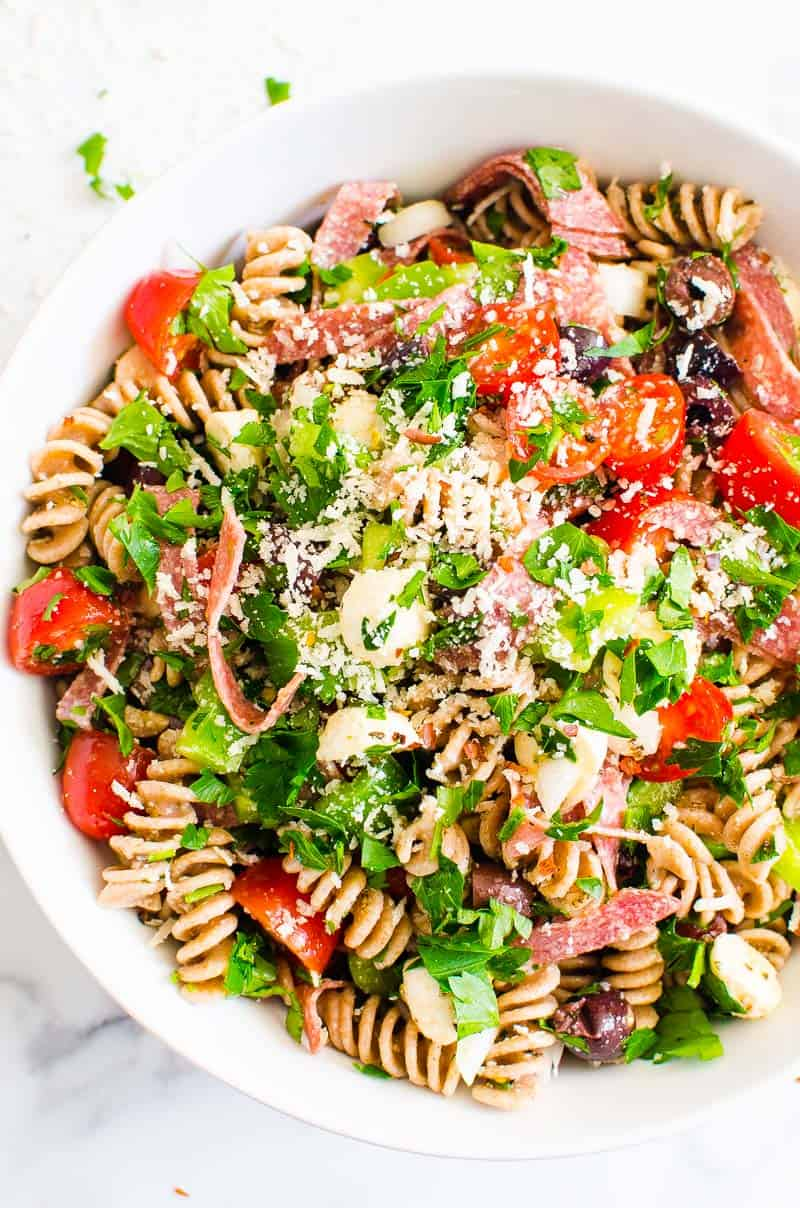 Italian Pasta Salad recipe garnished with parsley and parmesan cheese