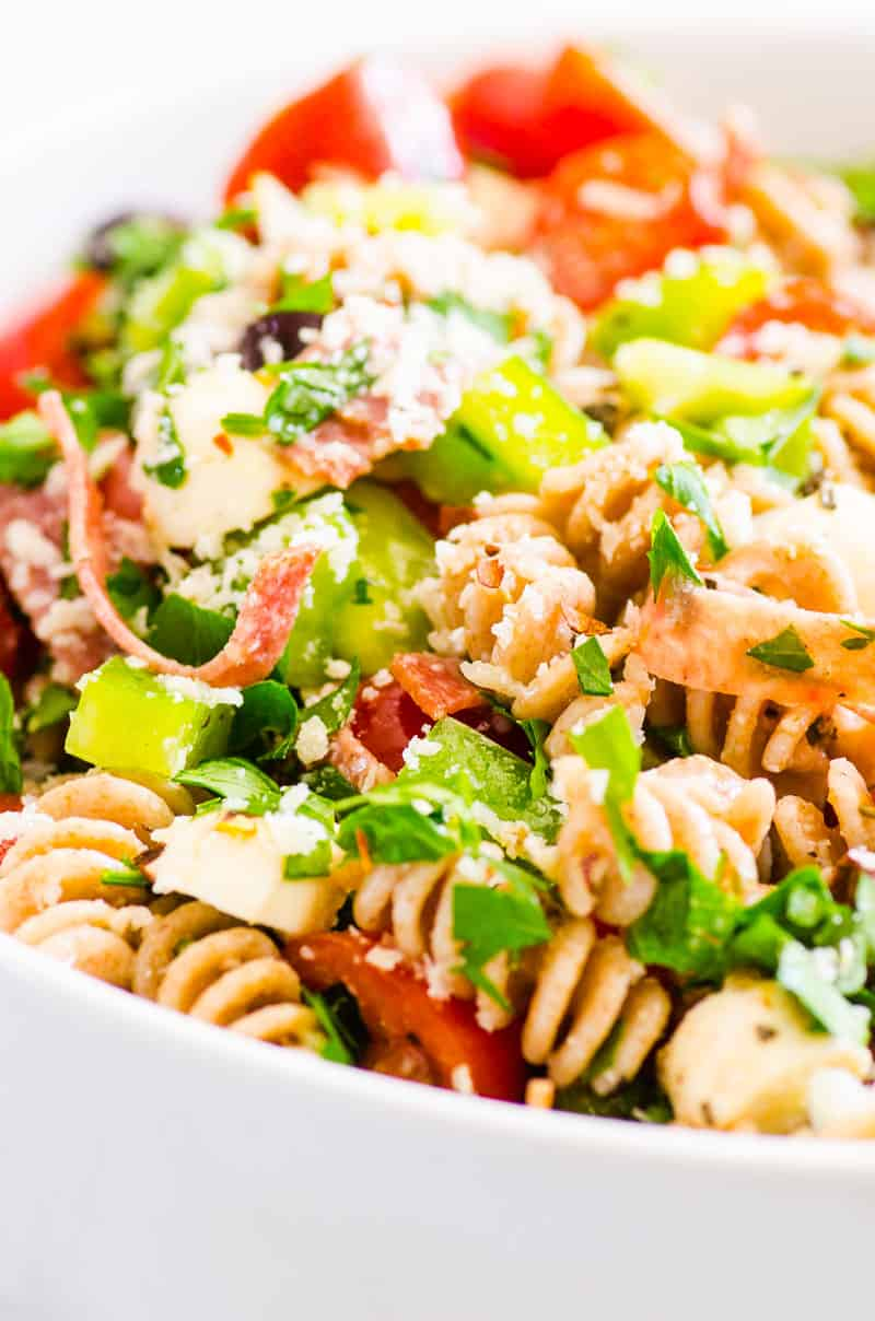 Italian Pasta Salad with parsley, parmesan cheese, bell pepper and salami closeup